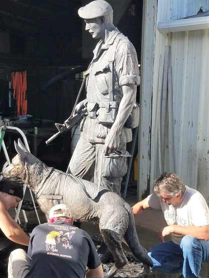 working on heroes and friends bronze monument